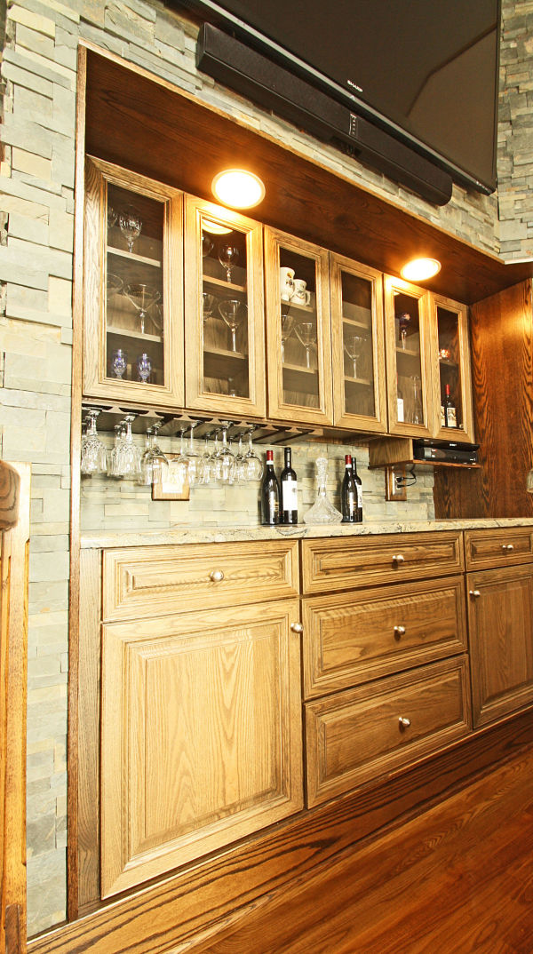 Built In Bar With Oak Cabinets By Bishop Cabinets And Ledge Stone Wall And  Backsplash