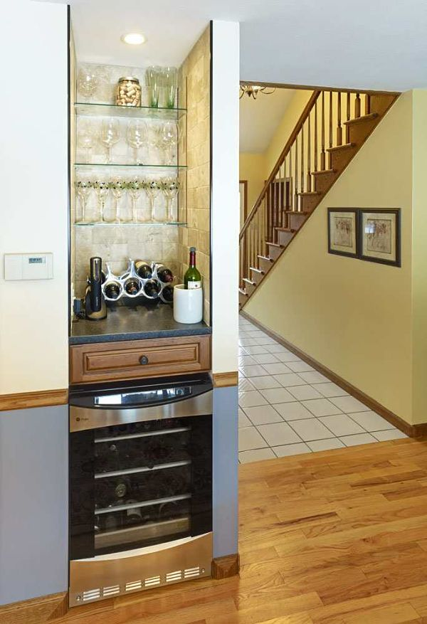 The Small Nook In This Kitchen Was Remodeled Into A Bar Area Complete With  Glass Shelving
