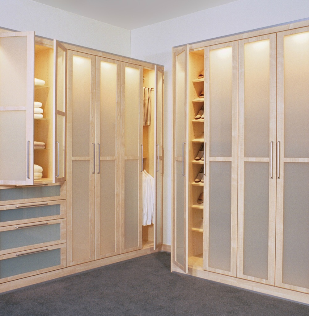 this custom closet features doors and drawers with translucent panels and built in lighting - Custom Closet Design Ideas