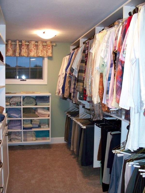 This Walk In Closet Combined Closet Rods, Drawers And Shelves To Create  Storage Space