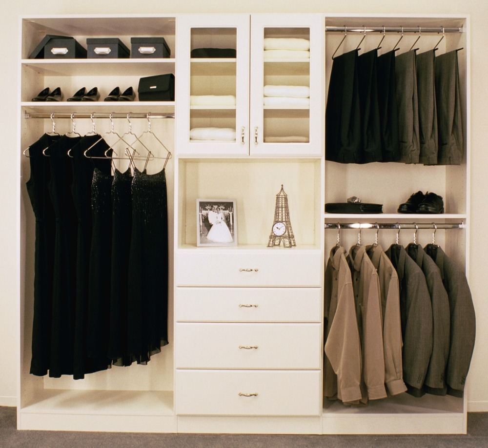 Attractive Closet Storage System With Multiple Rods, Shelves, And Drawers.