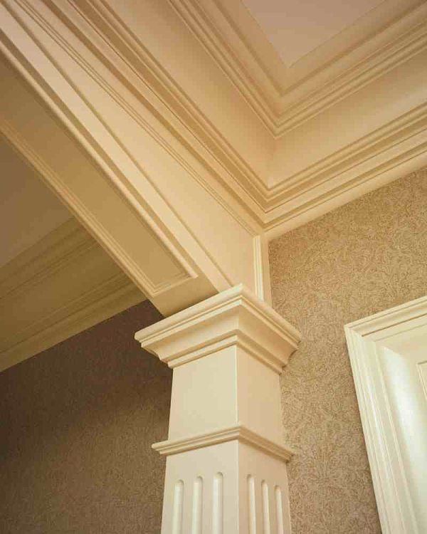 Trims can be layered over one another to completely transform any room into a showpiece. The fluted column and multi-step moldings are a beautiful feature in this home.