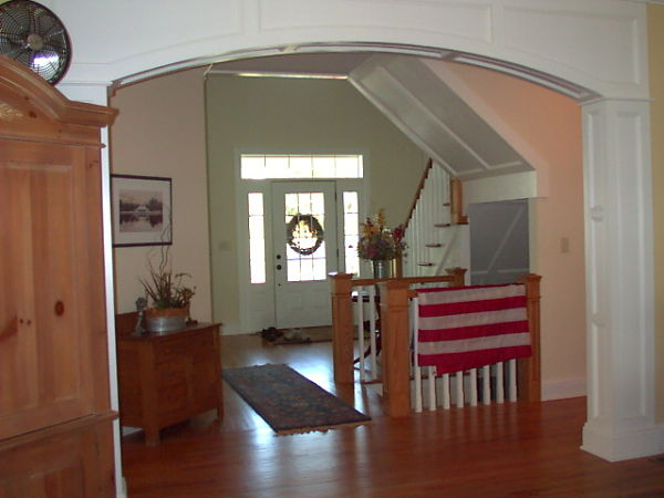 The archway between this living room and foyer defines the spaces while still giving the sense of openness.