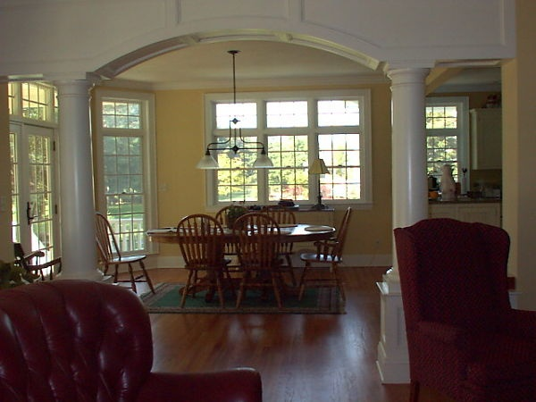 The columns and arch between the breakfast area and great room define the two separate spaces.