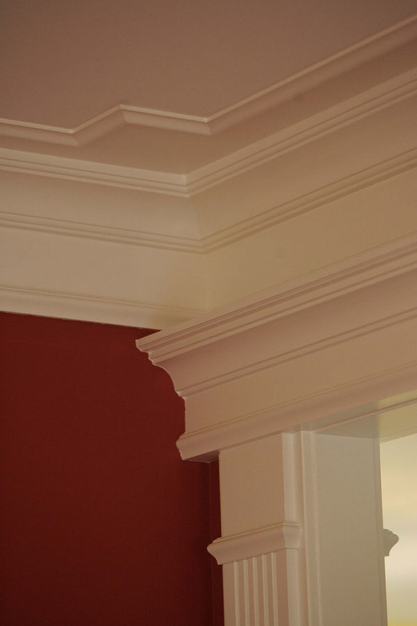 The fluted casing and crown molding add an elegant accent to this room.