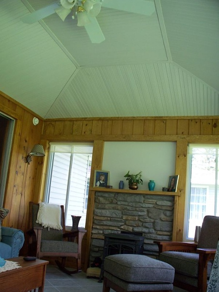 Family room with white wood ceiling.