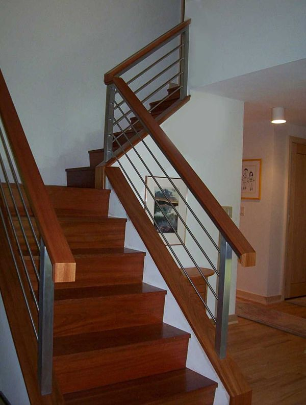 This Contemporary Staircase Was Built From Brazilian Cherry. Custom Crafted  Aluminum Handrails Accentuate The Clean