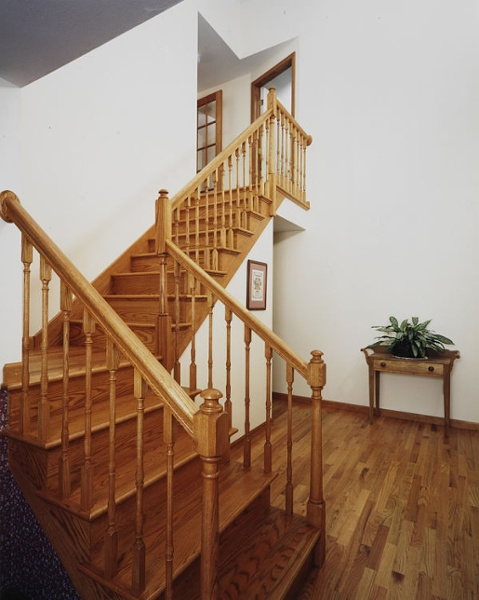 These finished oak stairs and railing give access to the new 2nd story addition on this home.