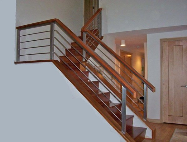 This custom handrail design uses both stainless steel and cherry to create a clean modern look.