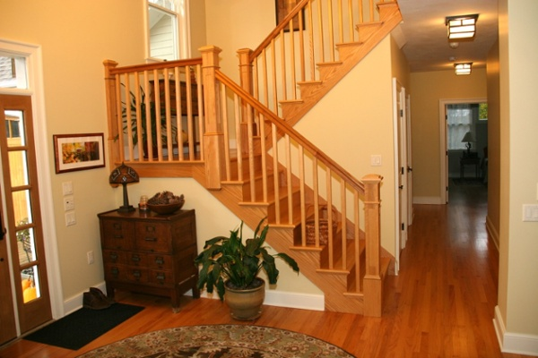 One of the many architectural accents in the home is a staircase with custom cherry rails and spindles.