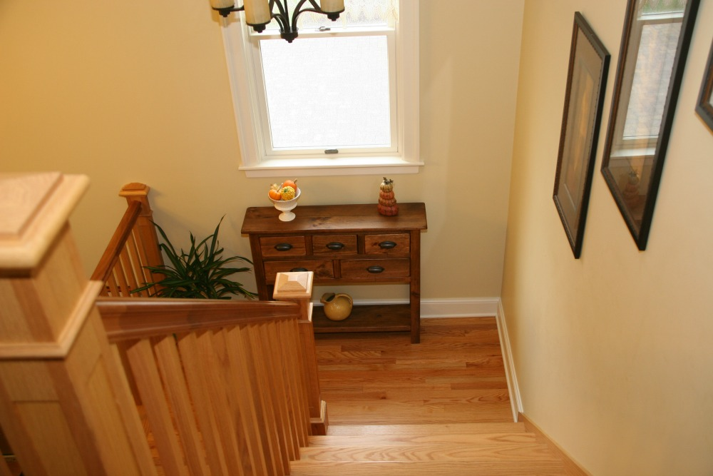 This Custom Cherry Staircase Complements The Red Oak Hardwood Floors On The  Landing.