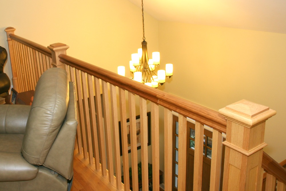 Close-up of custom cherry railings.
