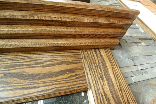 Oak trim was carefully crafted for the fireplace mantel.