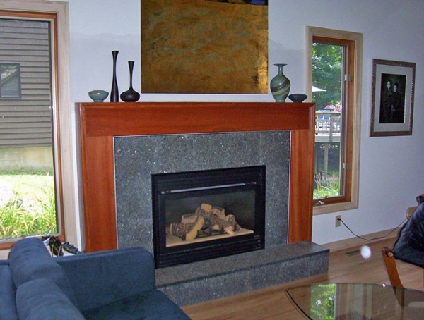 The stained wood and granite tile on this surround give this gas fireplace a completely new appearance.