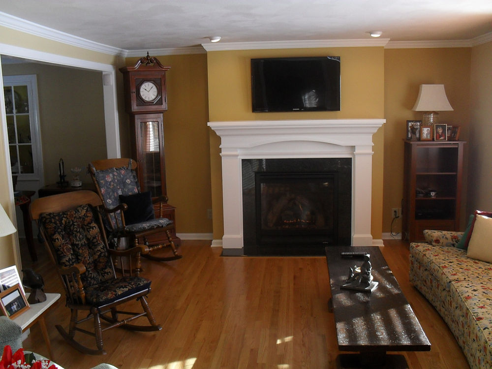 The addition of this gas fireplace and hanging TV was done by adding a small exterior bumpout as well as coming into the room. This ensured that the fireplace and walls would not take up too much space in the room.