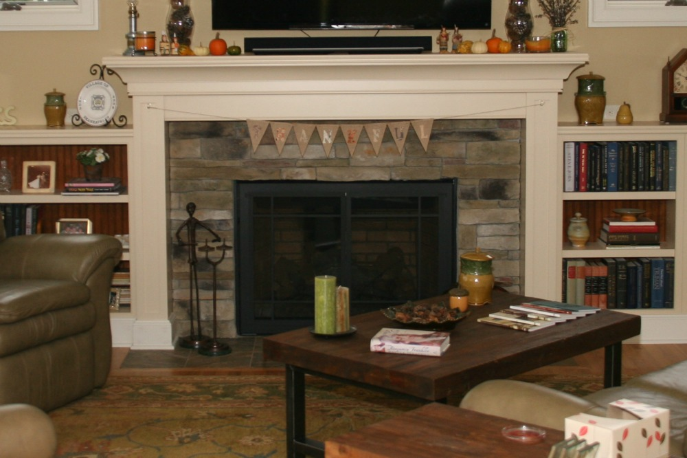 A fireplace is the focal point in rooms where people gather. This traditional-style gas-fueled fireplace is decorated for a Thanksgiving gathering. More homeowners are placing flat-screen televisions over fireplaces when they update living room and family room spaces.