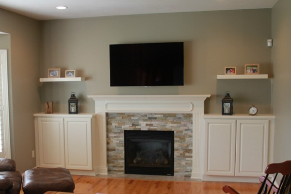 Updating a fireplace surround and hearth and adding built-in cabinets and shelves transformed this living room.