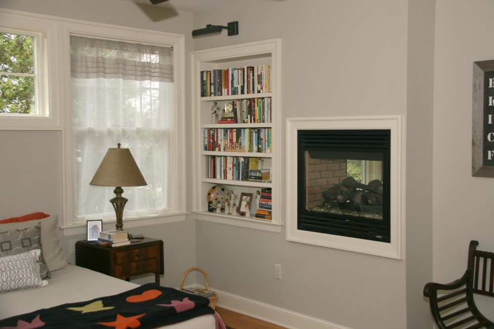 This two-way gas fireplace is shared by a bedroom and sitting porch.