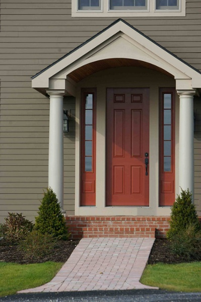Typically an entry door is 6-to-8 feet tall. This entry door is 8-foot tall and includes sidelites, one on each side. The 8-foot height gives a grand effect to this entrance.