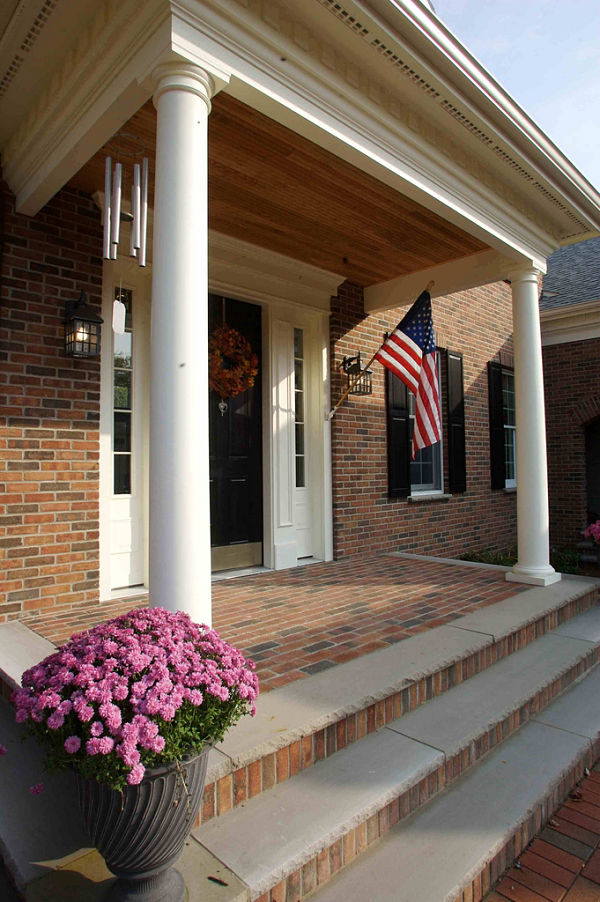 This Attractive Entry Includes An Overhang Supported By Tapered Round  Columns, Decorative Trim Above The