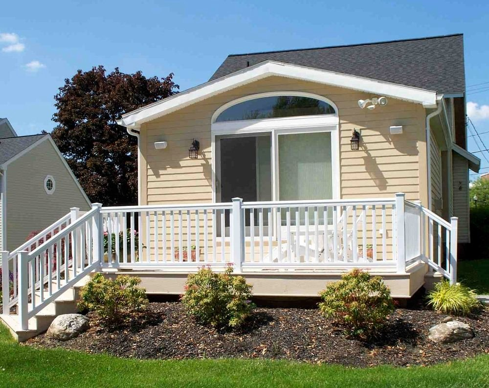 Deck railings installation remodeling company syracuse cny this two tone maintenance free deck includes composite decking and trim boards accompanied by a baanklon Image collections