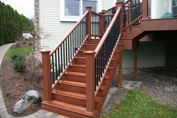 These steps connect the elevated deck with a walkway that runs from the front of the home to the lakeside dock. The steps and rails are composite materials from DuraLife. The steps were angled for both safety and aesthetics.
