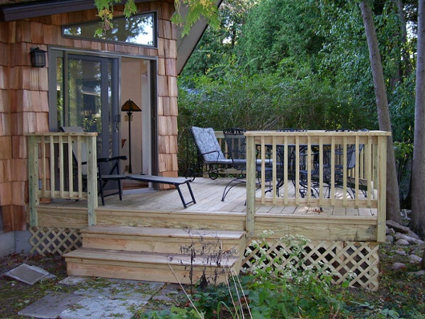 This simple pressure treated deck adds an affordable outdoor living space to this new addition.