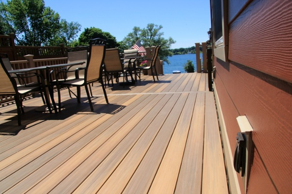 These composite deck boards closely resemble wood and are barefoot friendly since there are no exposed wood fibers or nails on the surface. The decking is also stain and fade resistant.
