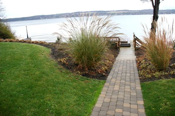 Walkway access to the dock and landscaped lakefront.