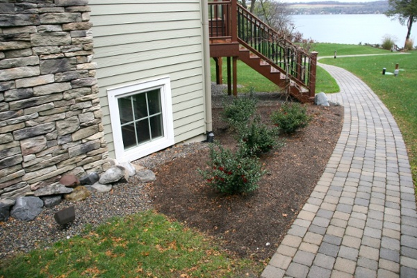 This walkway provides access from the front of the home to the lakeside dock. The ground was graded so that the walkway would not require steps.