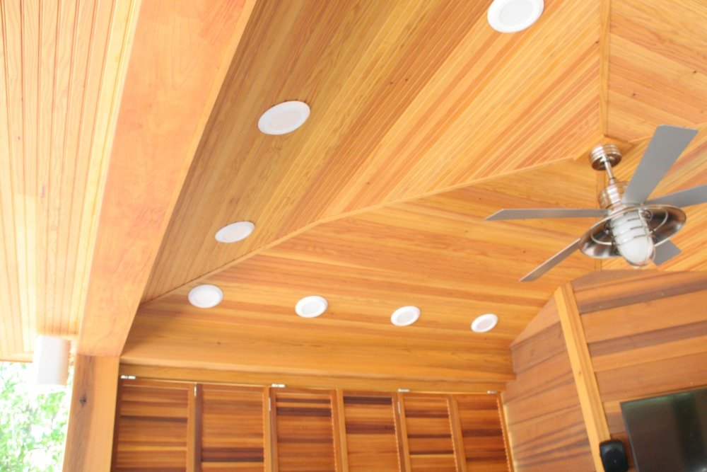 Lighting installed in this pavilion includes recessed lights with protective rims and lens caps installed over task areas and an industrial look paddle fan.