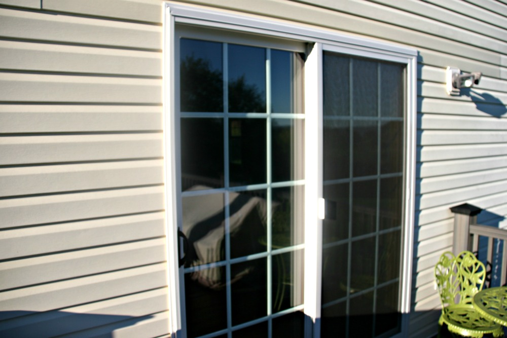Window door skylight repair services syracuse ny this new andersen gliding patio door with grills set between the glass and composite wood framing planetlyrics Images
