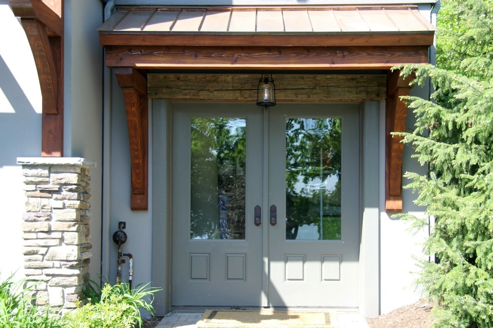 this back door entry was enhanced by adding wood posts and beams and a copper shed