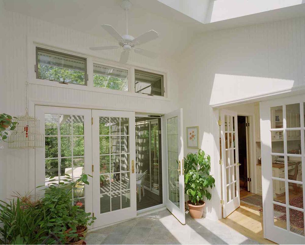 This breezeway addition provides natural light space and is an elegant transition from the main part of the home to the patio.