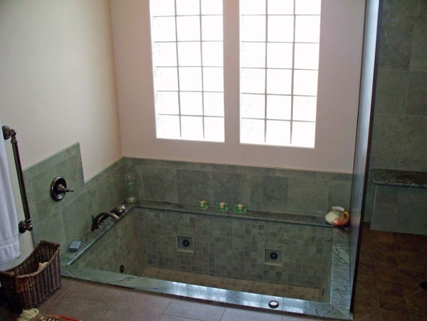 This 230-gallon tub was hand-made including its jet system. The recessed jets, granite surround and glass block windows add to the unique look and character of the tub, which recesses into the home's basement.