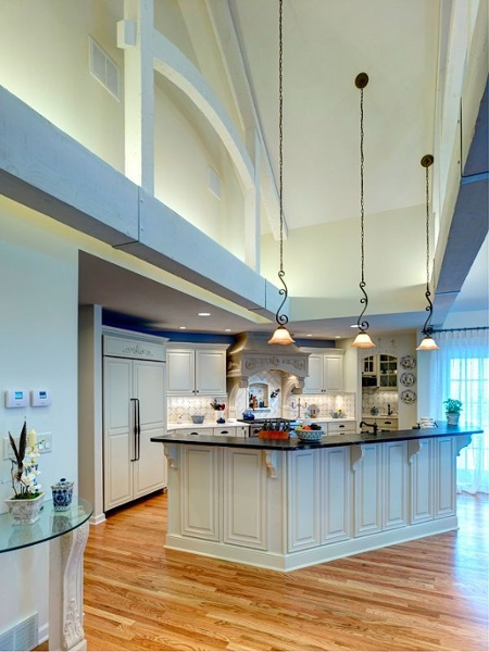 Among the outstanding features of this kitchen are its 15-foot high cathedral ceiling and hand hewn interior trusses spanning the 24-foot width of the room. There are many options for lighting including recessed, pendants and under-cabinet. Hidden uplights on the top of the wood beams light the cathedral ceiling.