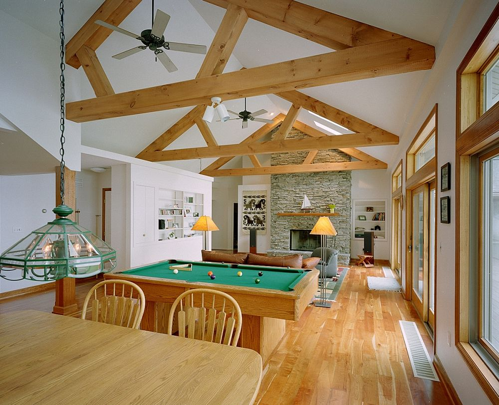 False ceiling beams, 5-inch plank cherry flooring and a stone faced fireplace add warmth and interest to this large multipurpose room.