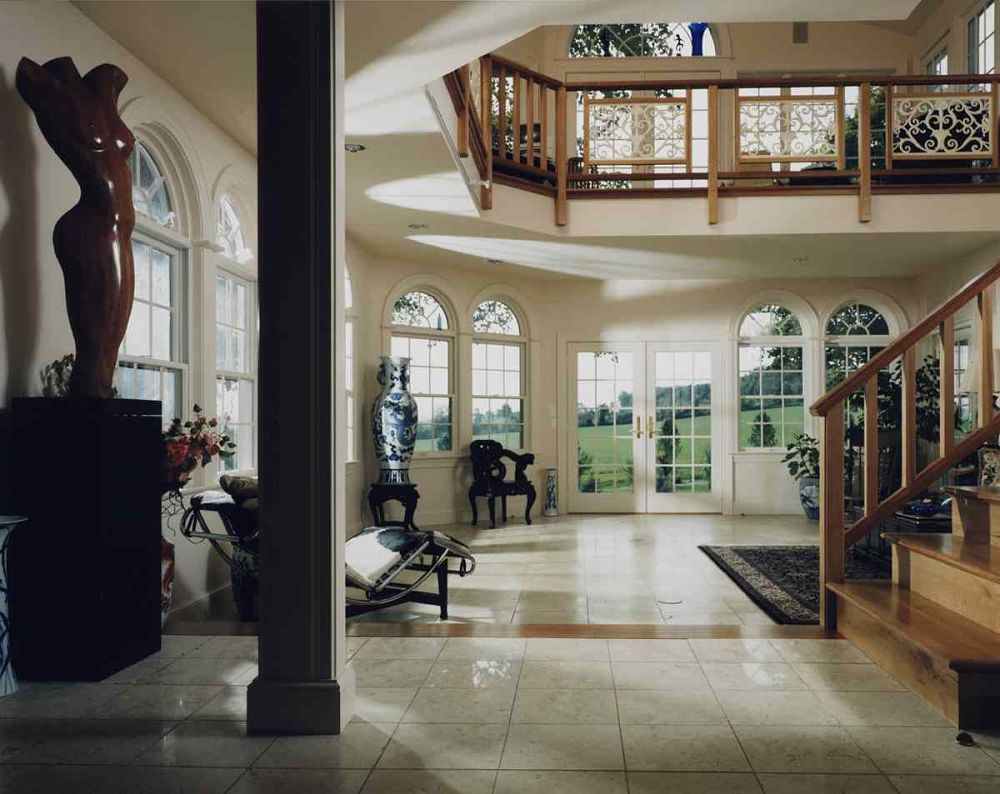 The marble floor, half-round topped windows and ornate trims add elegance and style to this unique two-story addition.