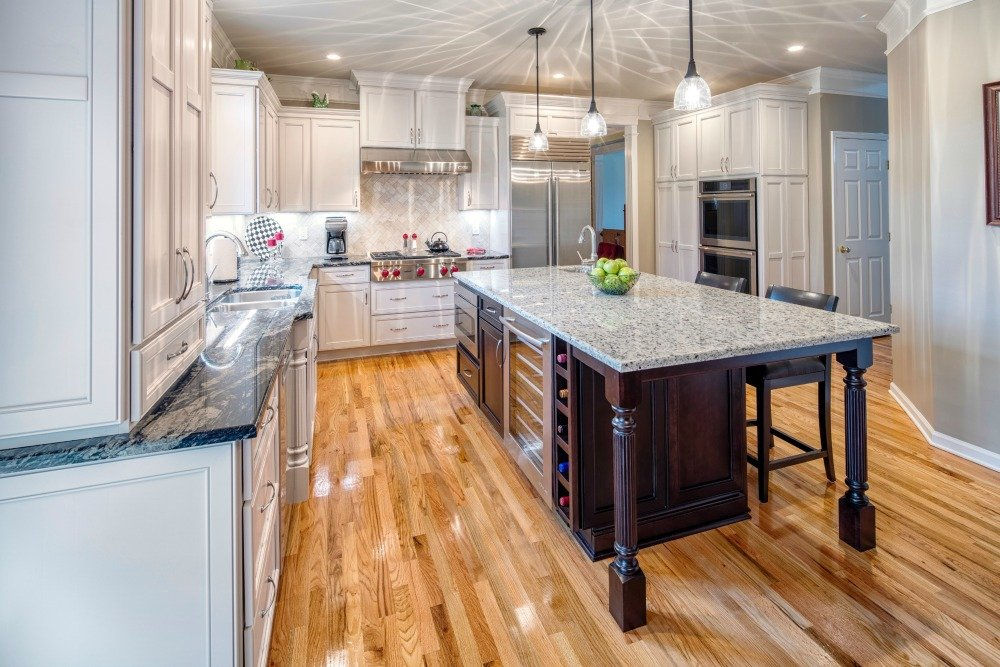 The Dimensional Look In The Kitchen Is Achieved By Installing Wall Cabinets  At Varying Heights And