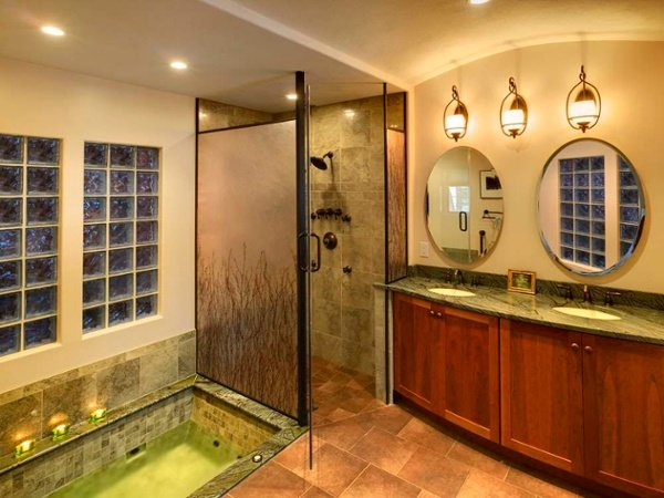 A dam-free walk-in shower is beneficial because there are no trip hazards upon entering the space. The floor is pitched to the drain so water stays out of the main bathroom floor.